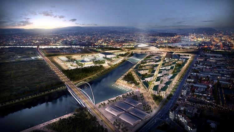 Budapest, 2017. január 4. A Budapest 2024 által 2017. január 4-én közölt legfrissebb aktuális látványterv az Olimpiai Park helyszíncsoportban található olimpiai faluról (jobbról), amelyet a IX., X. és XXI. kerületekben, a Kvassay-zsilip térségébe terveznek, és az esetleges 2024-es budapesti olimpia egyik helyszíne lesz. Elõtérben öt edzõcsarnok, balról a kör alakú ideiglenes teniszcsarnok, mögötte teniszpályák és mellette egy multifunkcionális csarnok, a vívás és a kézilabda sportágak versenyeihez. A látványtervet a Brick Visual, az építési terveket a BORD Építész Stúdió készítette. A 2024-es olimpia rendezési jogáért a magyar fõváros Los Angelesszel és Párizzsal verseng, a Nemzetközi Olimpiai Bizottság (NOB) szeptember 13-án, Limában dönt a helyszínrõl. MTI Fotó