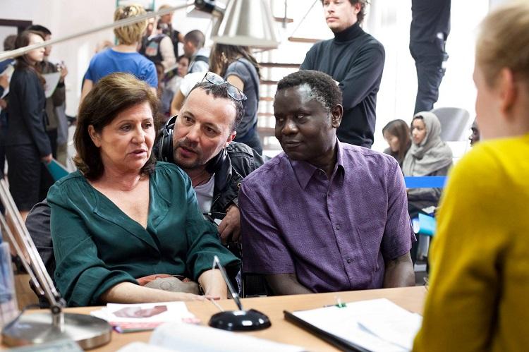Director Roland Vranik (center) directing stars Marcelo Cake-Baly and Ágnes Máhr on set.